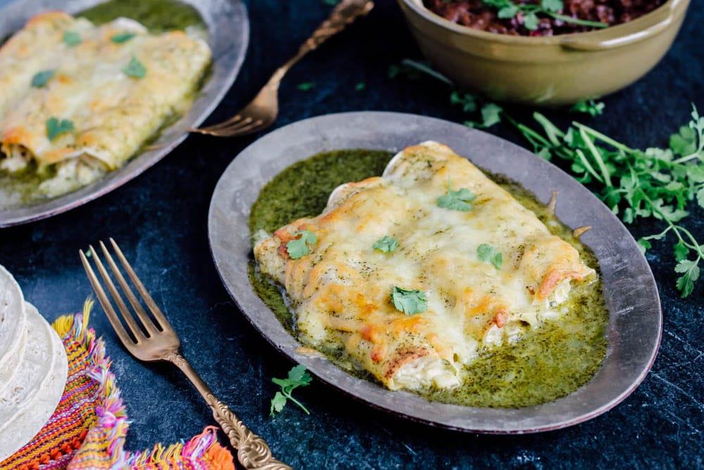 Green Chicken Enchiladas on a silver plate