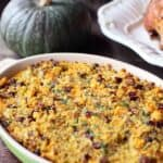 cornbread with bits of sausage in an oval casserole dish