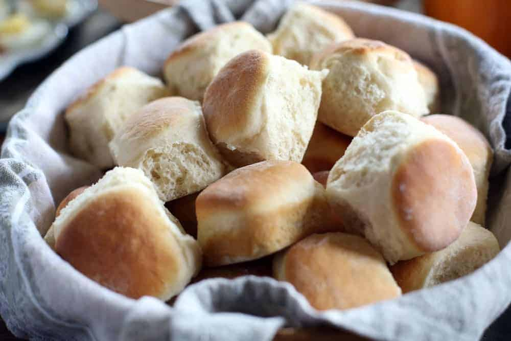 a bowl filled with homemade baked yeast dinner rolls