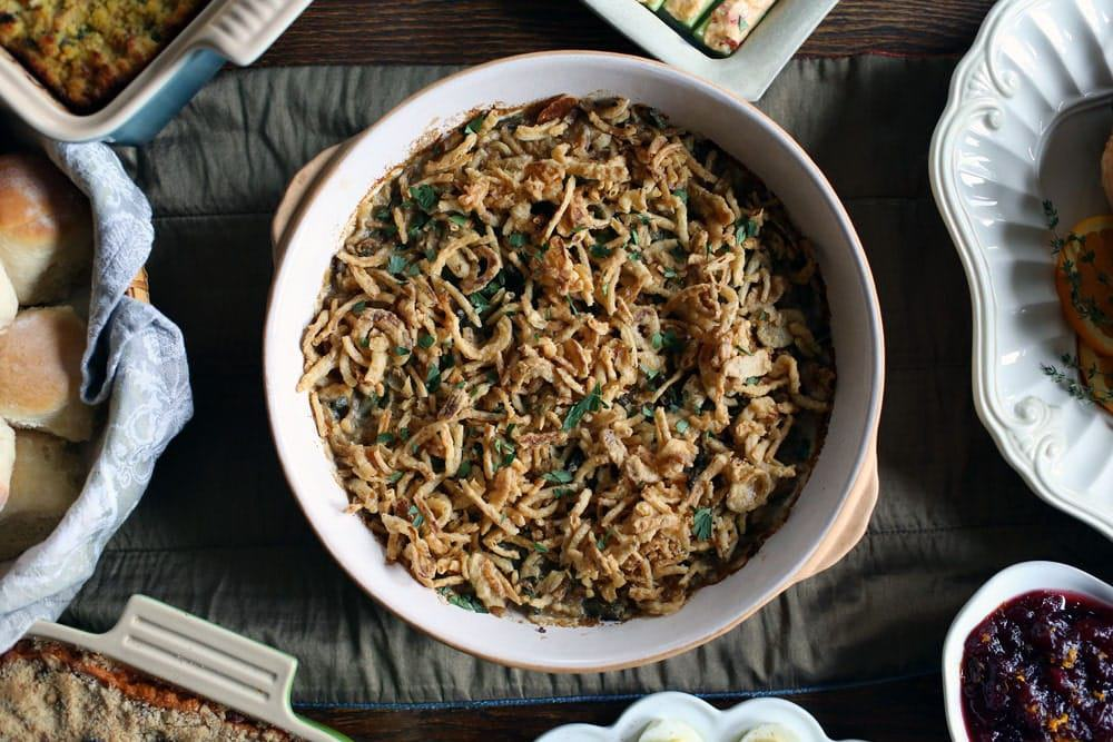 green bean casserole topped with French fried onions in a round casserole dish