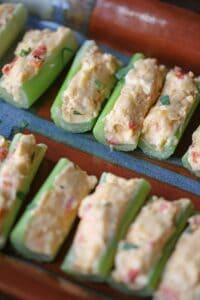 pimento cheese filled celery sticks on a serving platter