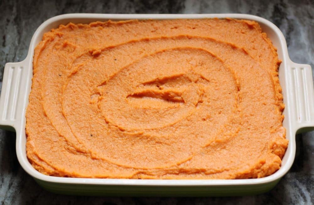 sweet potato puree swirled in a rectangular green baking dish