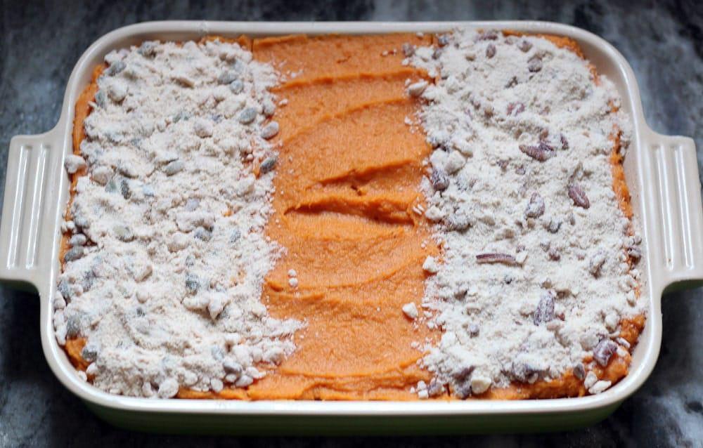 an unbaked sweet potato casserole in a baking dish