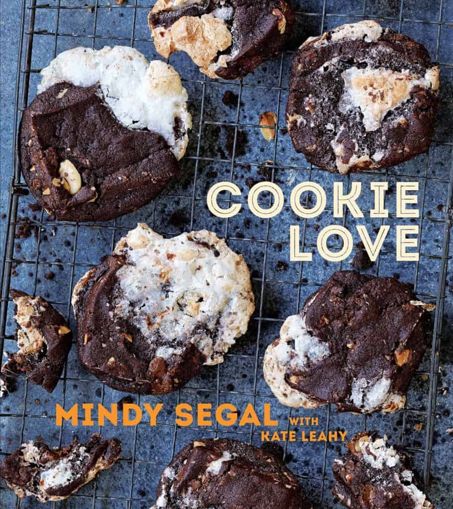 chocolate cookies on a wire rack on the cover of the book Cookie Love by Mindy Segal