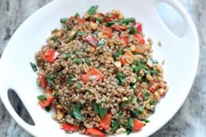 Crispy Farro with Peanuts, Scallions and Peppers in a white serving bowl