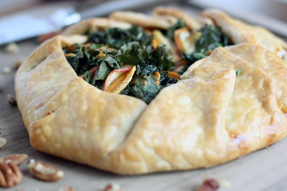 baked golden brown galette filled with kale, apple, and sweet potato