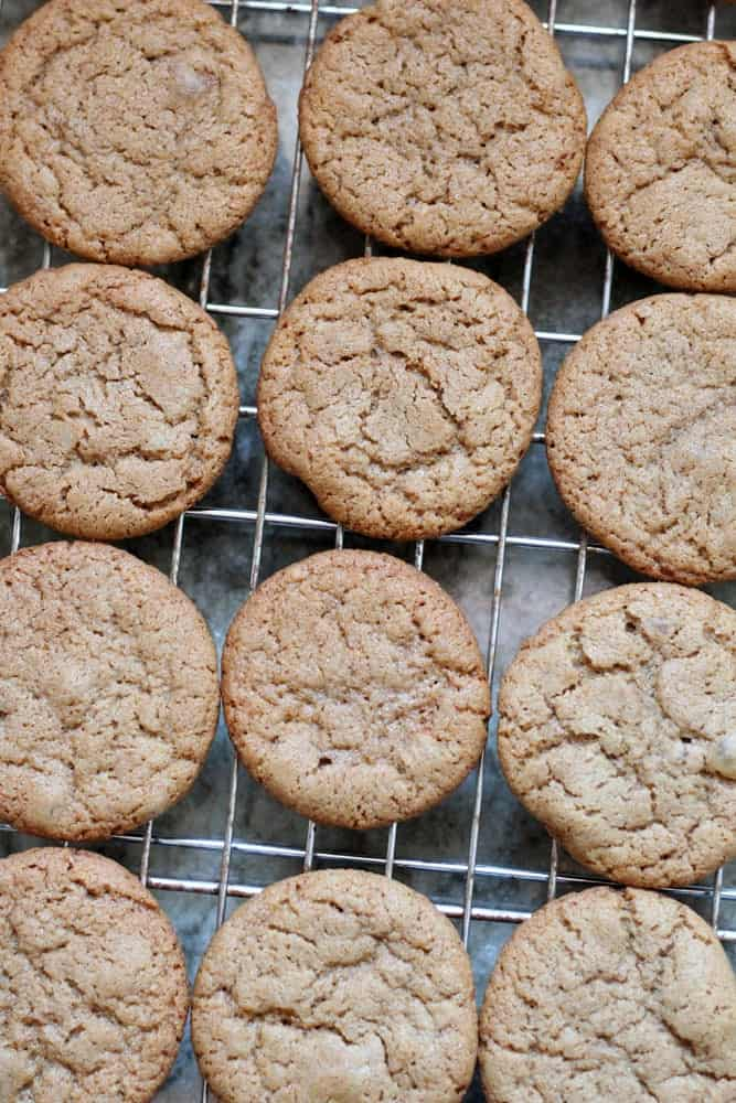light brown colored ginger cookies on a wire cooling rack
