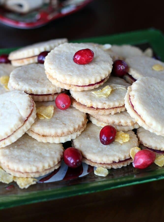 round sandwich cookies garnished with corn flake cereal and cranberries