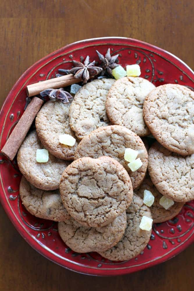 Ginger Cookies on a round red plate with candied ginger sprinkled over top