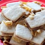shortbread sandwich cookies filled with caramel and garnished with fritos