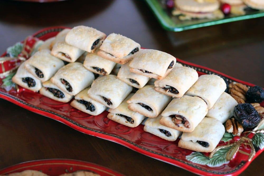 Fig Pecan Newton cookies stacked in a pyramid on a long red serving platter