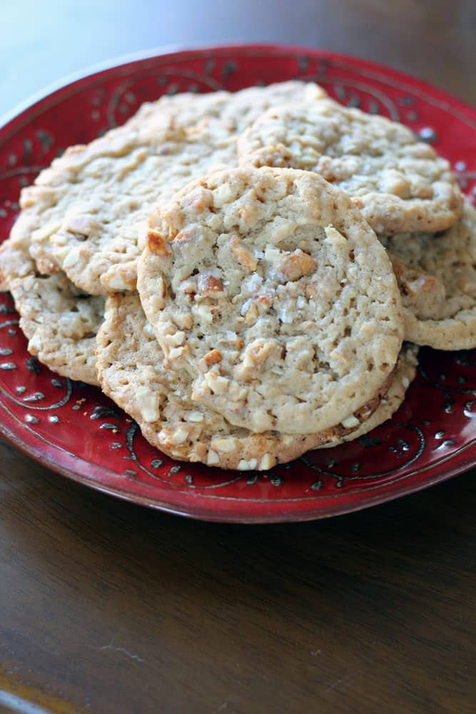 light brown colored cookies garnished with salt on a red plate