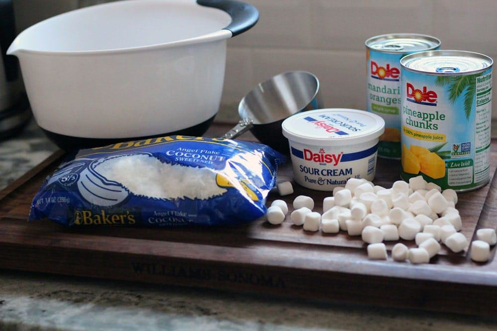 ingredients for 5-cup ambrosia salad on a wooden cutting board