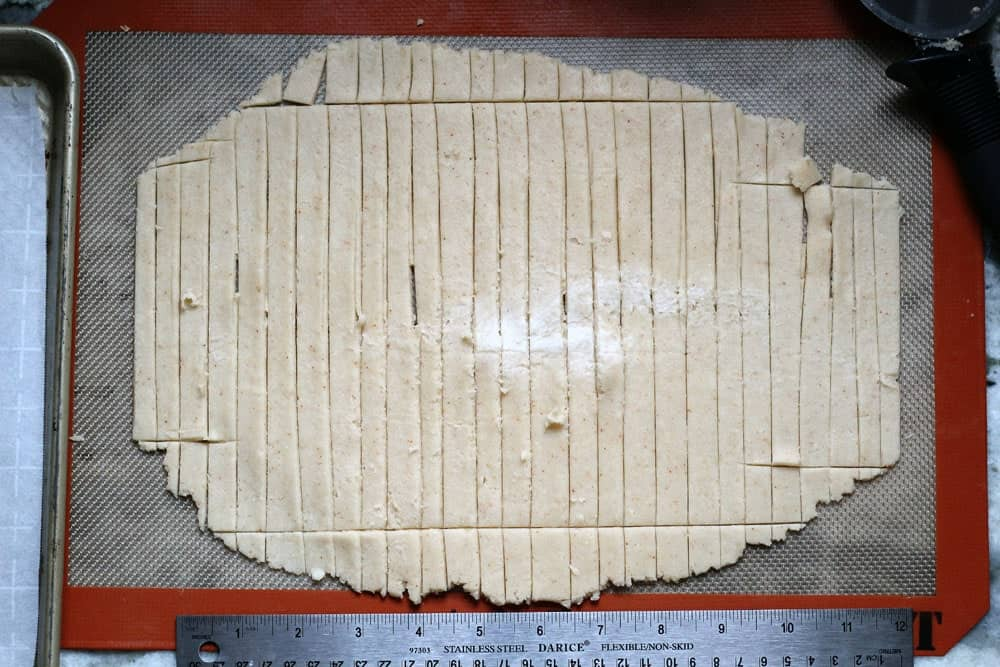 a sheet of pastry dough cut into long, narrow rectangles