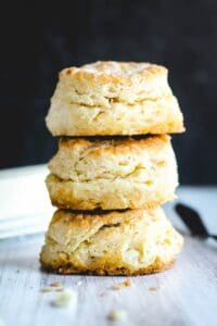three Buttermilk Biscuits stacked on top of each other