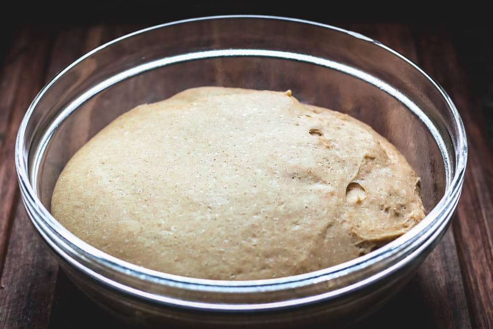 raw dough for Cinnamon Swirl Bread in a glass bowl after rising