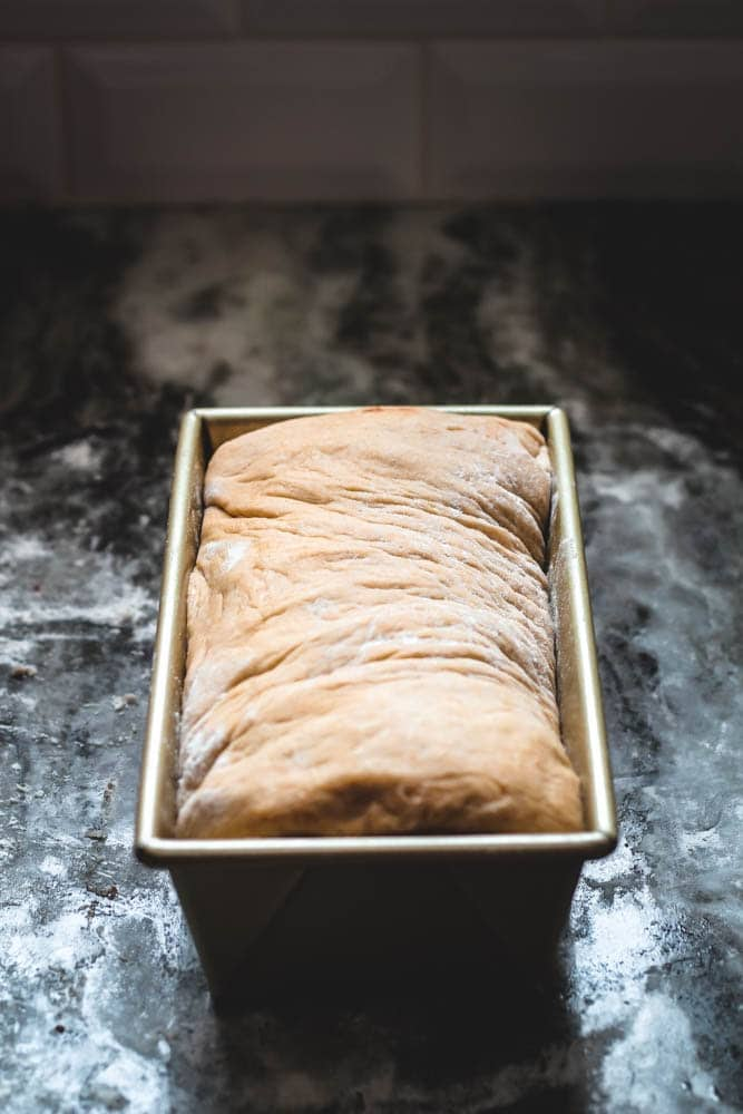 Cinnamon Swirl Bread completed in a loaf pan and ready for one last rise before the oven