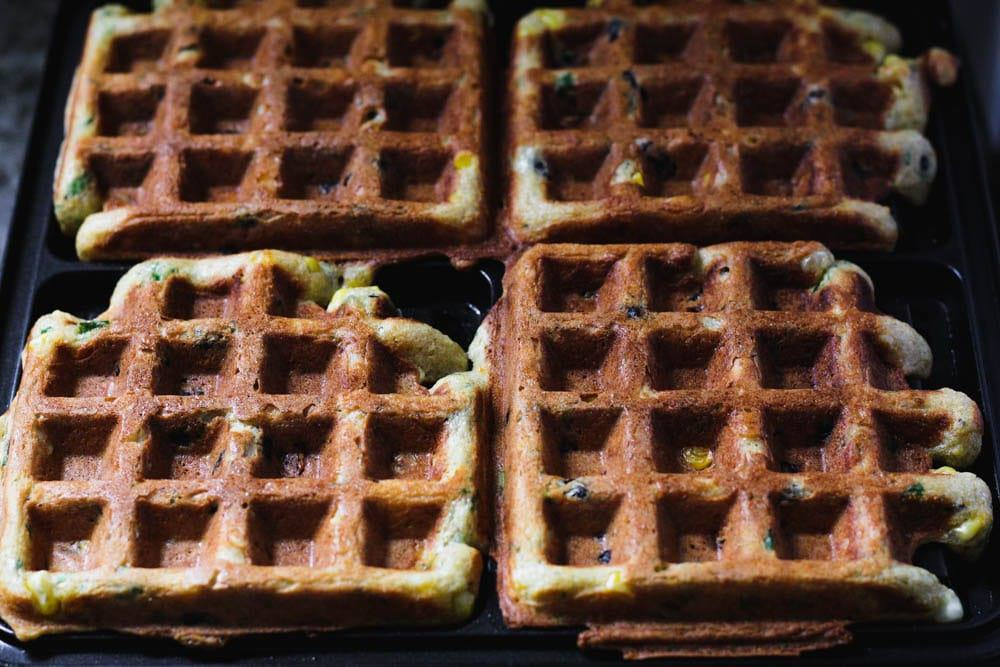 cooked black bean and corn waffles on the waffle iron