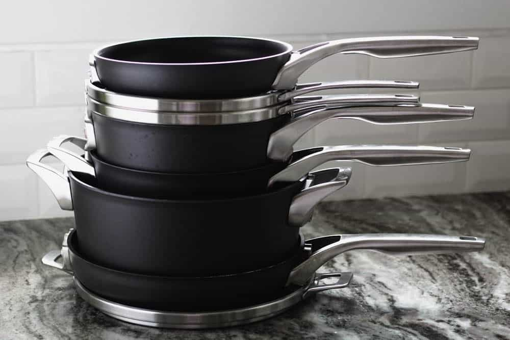 stack of Calphalon pots and pans