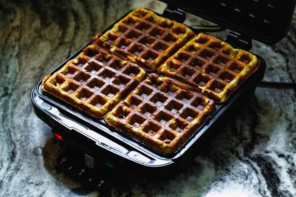 cooked falafel waffles in a waffle maker