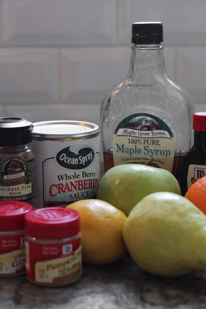 the ingredients required for Cranberry, Apple and Pear Bars which include chinese five spice, ground ginger, pumpkin pie spice, canned cranberry sauce, maple syrup, vanilla extract, lemon, orange, pear and apple