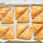 Louisiana Meat Pies on a parchment lined baking sheet