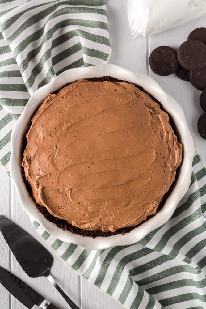 whole and unsliced brown thin mint no bake chocolate cheesecake before garnishing
